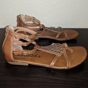 Brown strapped and studded gladiator sandals